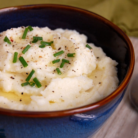 Mashed Cauliflower with Garlic- this is so good! You need to try this healthier alternative to mashed potatoes.