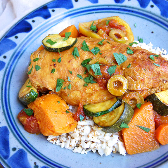 Paleo Chicken Tagine with Olives and Sweet Potatoes- I love this dish so much! Full of flavor and absolutely delectable.