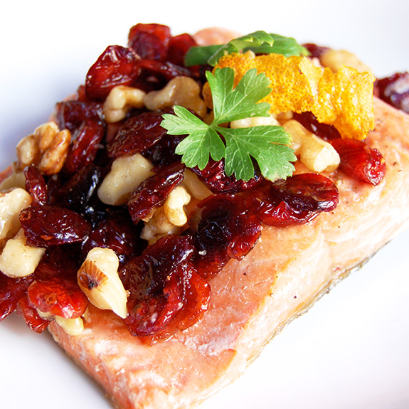 Pan-Seared Salmon with Candied Oranges and Cranberry Walnut Relish- this delicious salmon dish is really easy to make and has such beautifully complex and bright flavors.