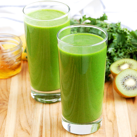Kale and Kiwi Superpowered Green Smoothie- one of my all-time favorite Paleo smoothies! I feel like I could punch through a brick wall after drinking this, lol. Seriously though.