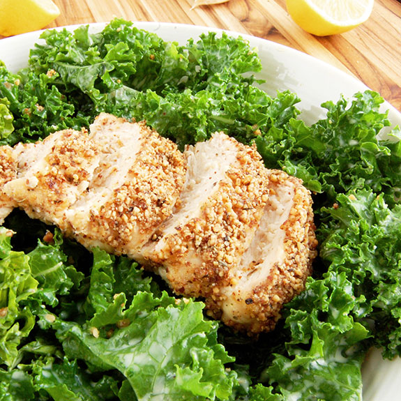 Kale Caesar Salad with Almond-Crusted Chicken- This recipe introduces an updated version of classic Caesar salad. Kale is substituted as the base of the salad instead of romaine because of its nutritional punch and heartiness. Along with creamy homemade dressing, the salad is topped with crunchy almond-crusted chicken. Only wholesome, natural ingredients are used for this filling meal.