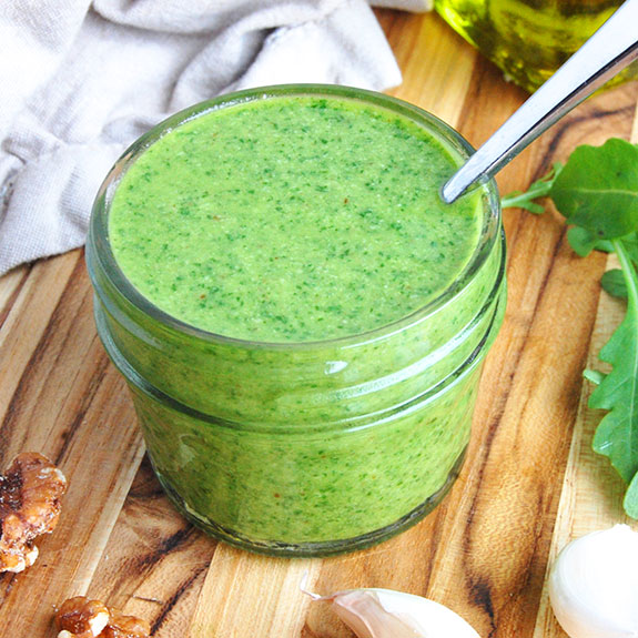 Fresh and Easy Arugula Pesto- A garlicky, peppery and perfectly balanced pesto! Plus, it is completely dairy free and gluten free.