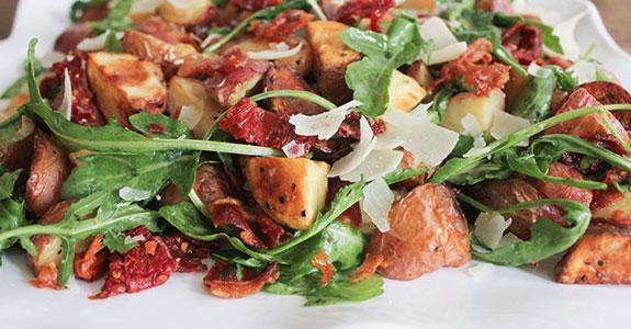 Roasted-Potato-Salad-With-Pancetta,-Sundried-Tomatoes,-and-Arugula