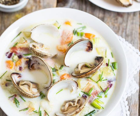 I love this clam chowder! It has tons of fresh vegetables along with plenty of clams and salty pieces of bacon.