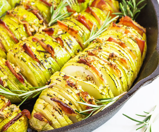 You'll love our rosemary garlic hasselback zucchini because it's stuffed with salty bacon. Plus it's easy to make so you can whip it up quickly and get it in the oven.