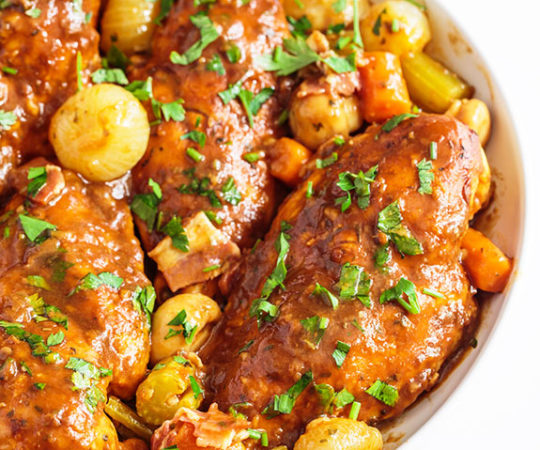 Bacon + Slow Cooked Chicken + a Savory, Rich Sauce = HEAVEN. If you haven't tried this easy to make slow cooker coq au vin yet, go to the grocery store right now and make it tonight!