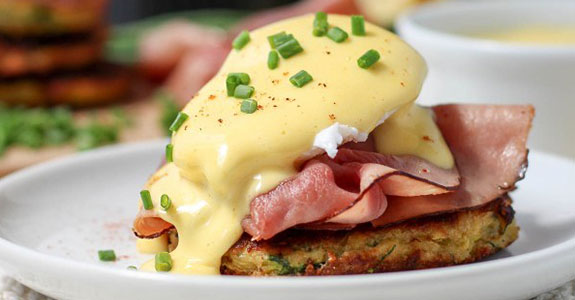 Zucchini Fritter Eggs Benedict With Prosciutto and Bacon