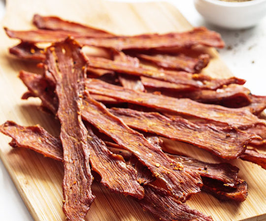 Beef jerky may have been the cowboys' best invention: the wholesome goodness of meat, packed with tons of protein, in an easy to carry form that keeps for days. So take the time to bake a little jerky and you'll have days of snacks ready to go.