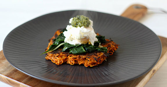 Sweet Potato Fritters With Garlicky Greens, Poached Eggs, and Pesto