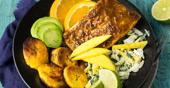 Orange Jerk Salmon With Mango Coconut Slaw and Fried Plantains