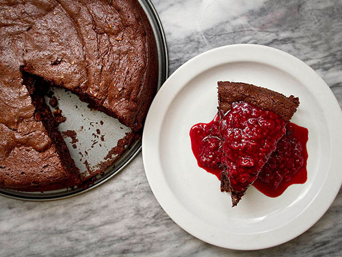 Flourless Chocolate Date Cake With Raspberry-Maple Sauce