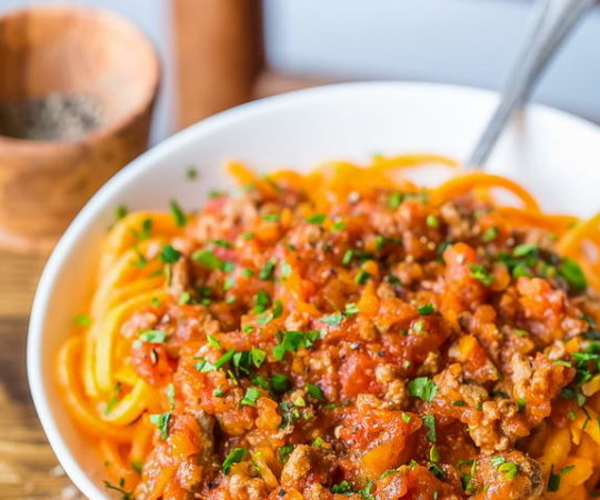 Enjoy a Paleo version of an Italian favorite: Bolognese sauce with sweet potato noodles.