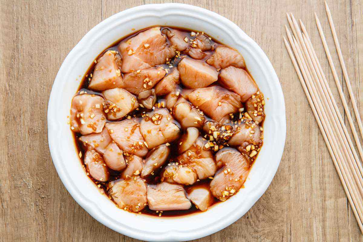 marinating raw chicken in teriyaki sauce
