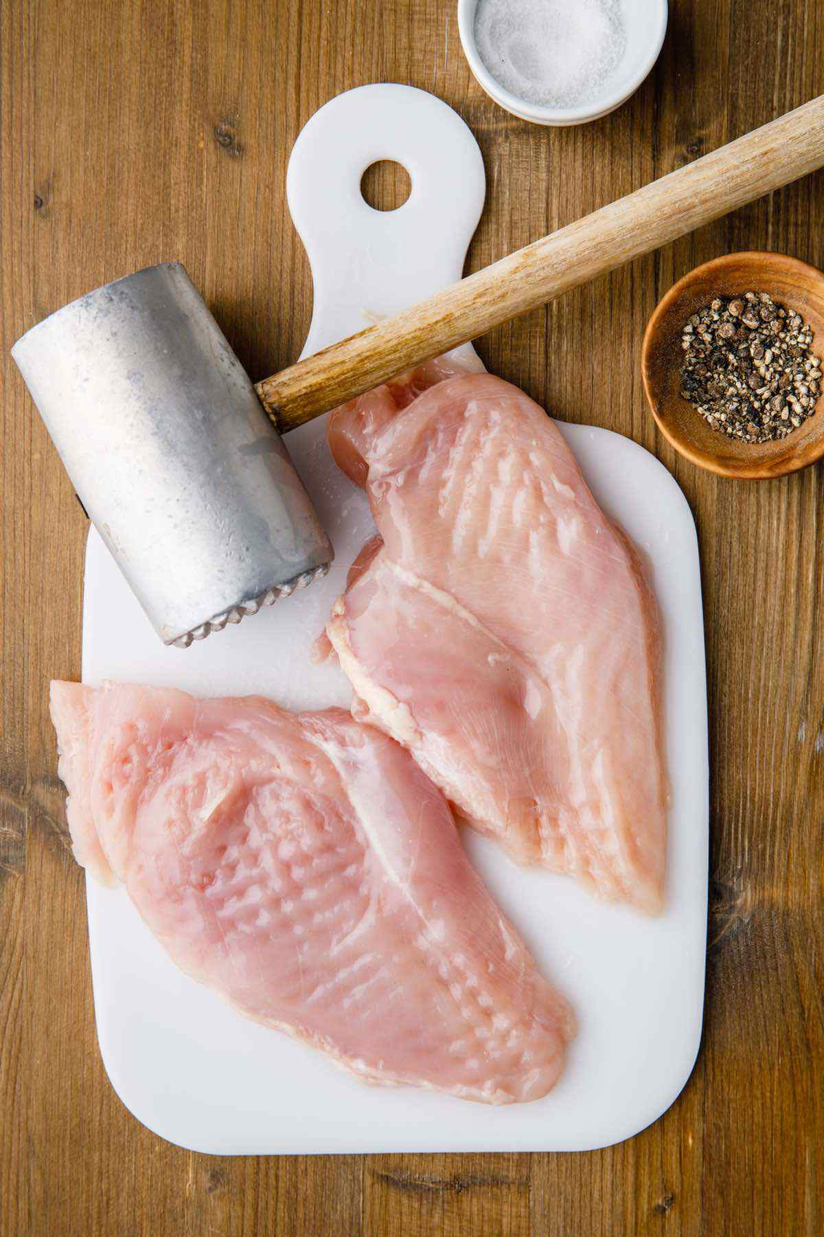 prepping raw chicken breasts