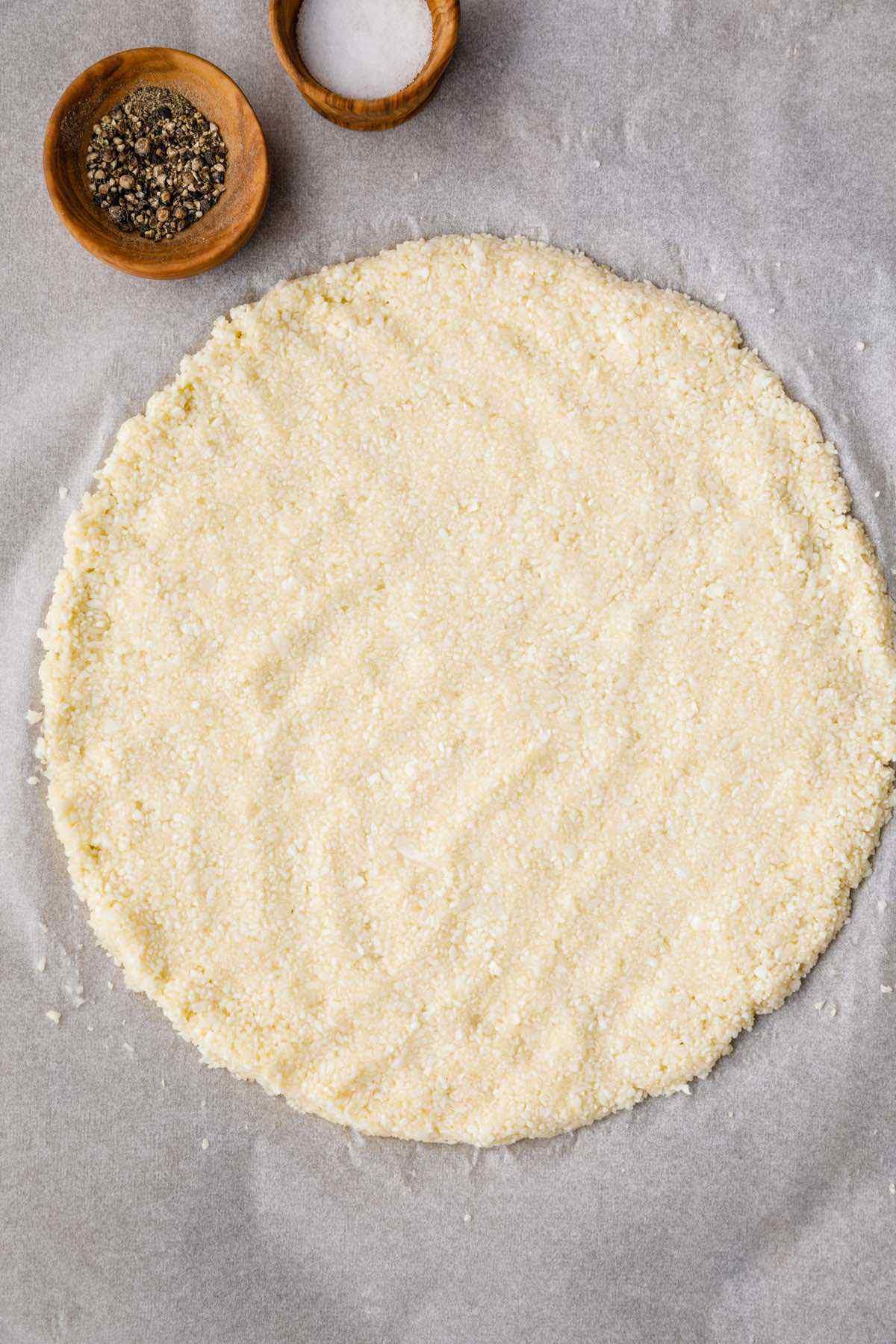 shaping cauliflower pizza crust