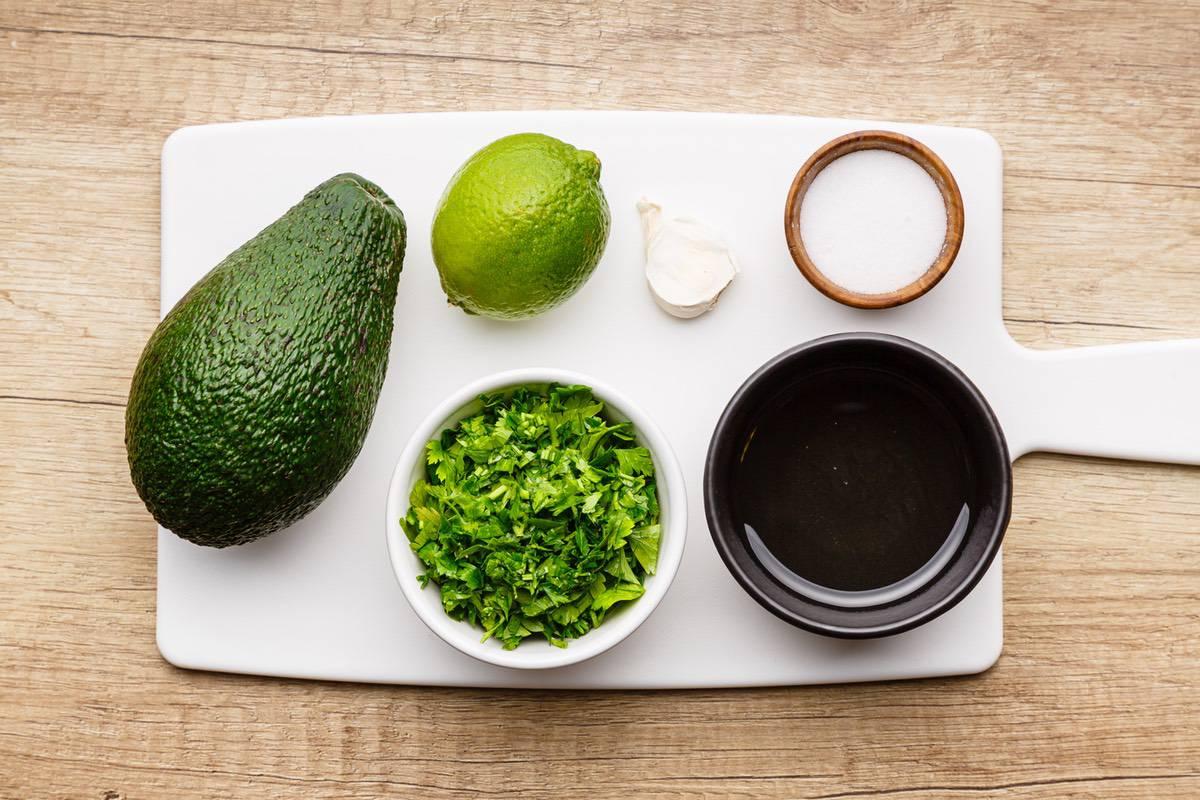 Home.fit cilantro-lime-dairy-free-avocado-dressing-1 Creamy Avocado Cilantro Lime Dressing (Dairy-Free)